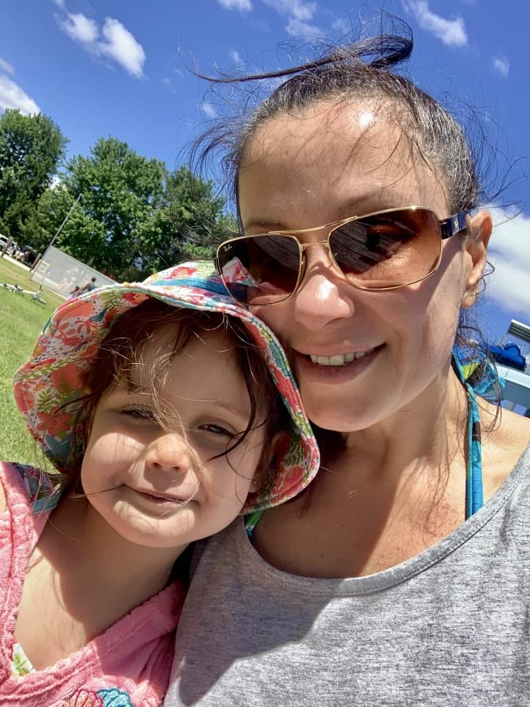 Being Single Mom with Sunglasses and Daughter wearing hat