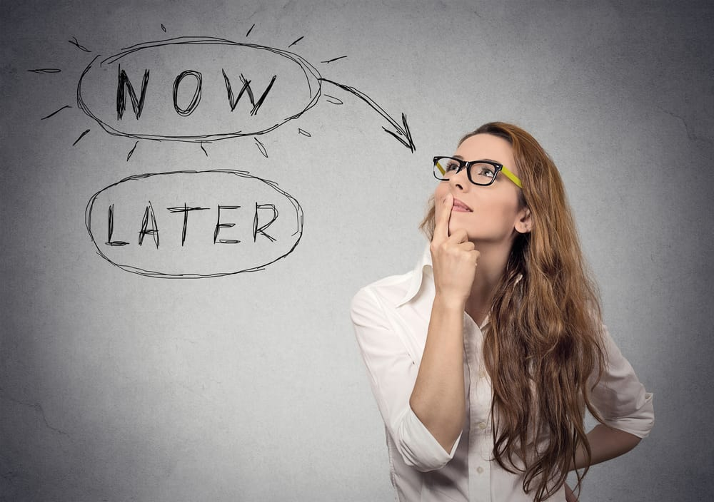 How To Stop Procrastinating. Now or later. Woman thinking looking up. Human face expression