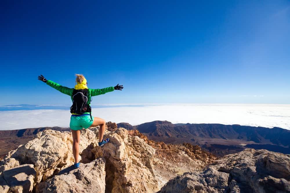Inspirational Women Woman climbing success in mountain top