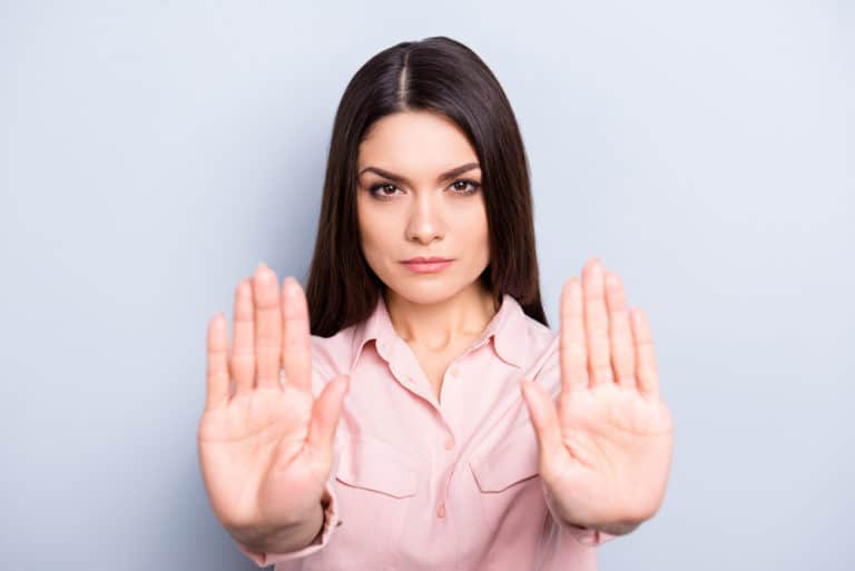 Overcome Fear Portrait of serious, unhappy, confident brunette woman gesturing