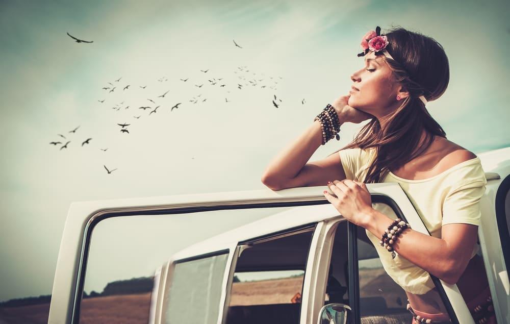Enjoy The Journey Hippie girl in a minivan on a road trip