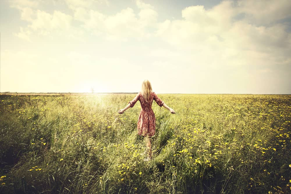 Self Discovery Journey dreamy woman walking in nature towards the sun